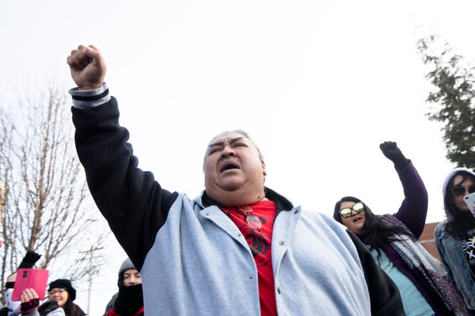 Albert Ortiz chants during a protest of the Catholic Diocese of Covington outside the Diocese of Covington building in Covington, Kentucky, on Tuesday, Jan. 22, 2019.  The protest was planned by the American Indian Movement in response to incident in Washington DC when students of Covington Catholic High School were filmed in an altercation with a Native American man.