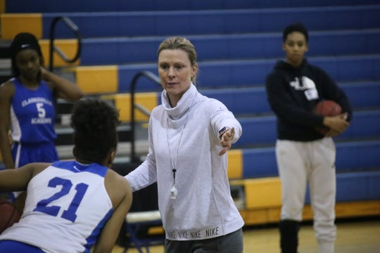 Clarksville Academy coach Carrie Daniels gives her players pointers on how to run a drill during practice Tuesday.