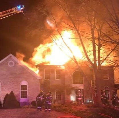Three Raritan Township police officers rescue woman trapped in house fire on Becks Boulevard