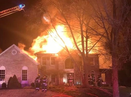 Three Raritan Township police officers rescued an elderly woman from a house fire early Tuesday morning.