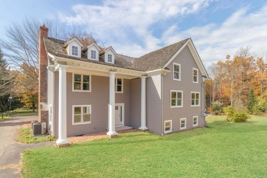 An updated custom home is for sale at $875,000 that is situated on just over two level acres bordered by woodlands in the Basking Ridge section of Bernards Township.