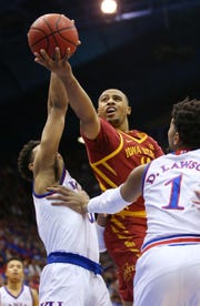 Iowa State Cyclones guard Talen Horton-Tucker (11) shoots as Kansas Jayhawks guard Quentin Grimes (5) and forward Dedric Lawson (1) defend in the first half at Allen Fieldhouse.