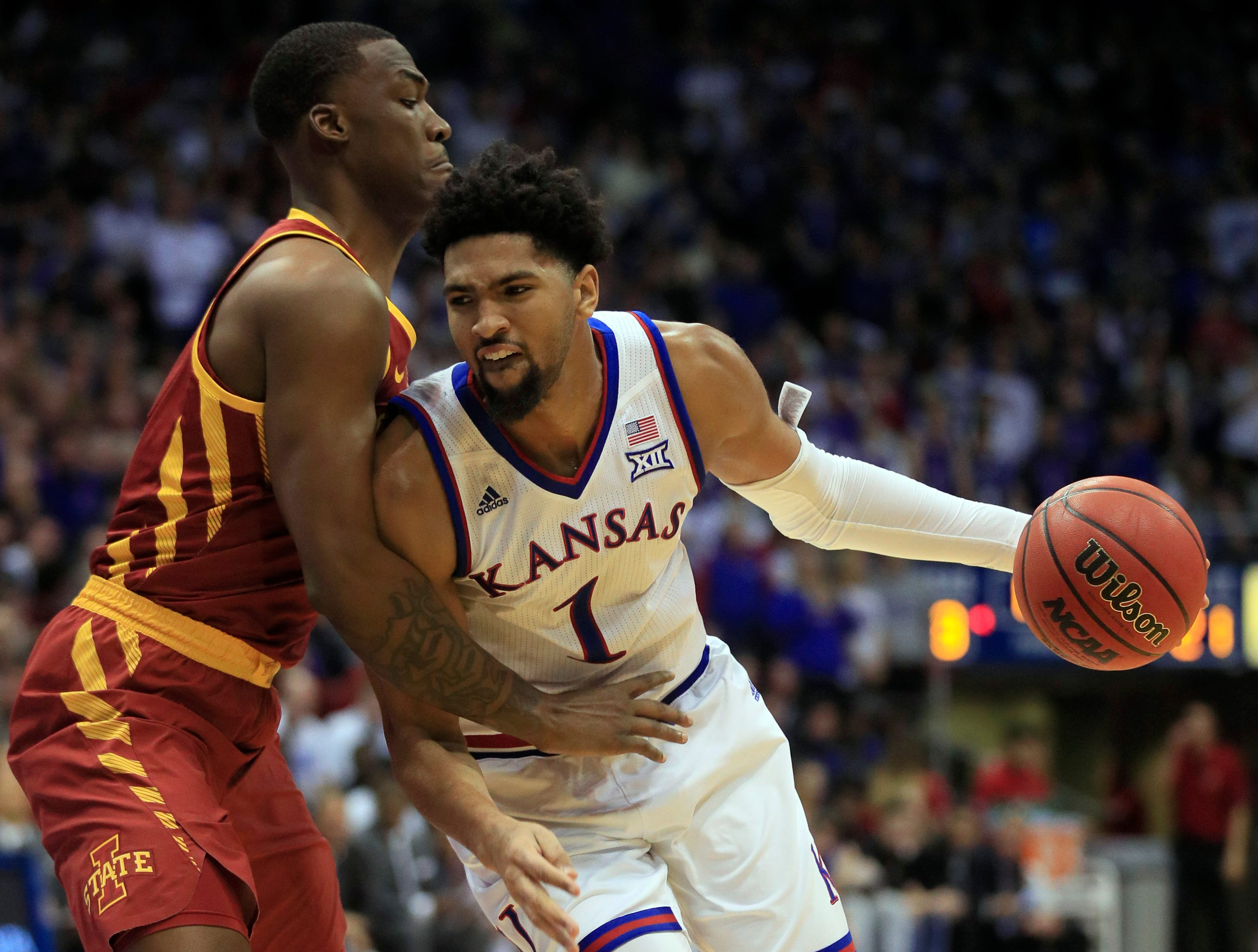 Kansas forward Dedric Lawson (1) is fouled by Iowa State forward Cameron Lard, left, during the first half of an NCAA college basketball game in Lawrence, Kan., Monday, Jan. 21, 2019.