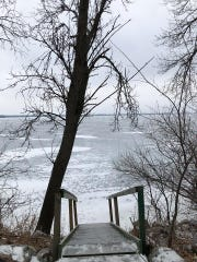 Rescuers used this staircase, which connects to a dock in warmer months, to reach a family whose car fell through the ice Sunday night, said witness April Brown. Zackary Newlon and his 8-year-old son, Blair, died. Newlon's daughters, Sidney, 9, and Sophie, 5, remain hospitalized, a family member said.