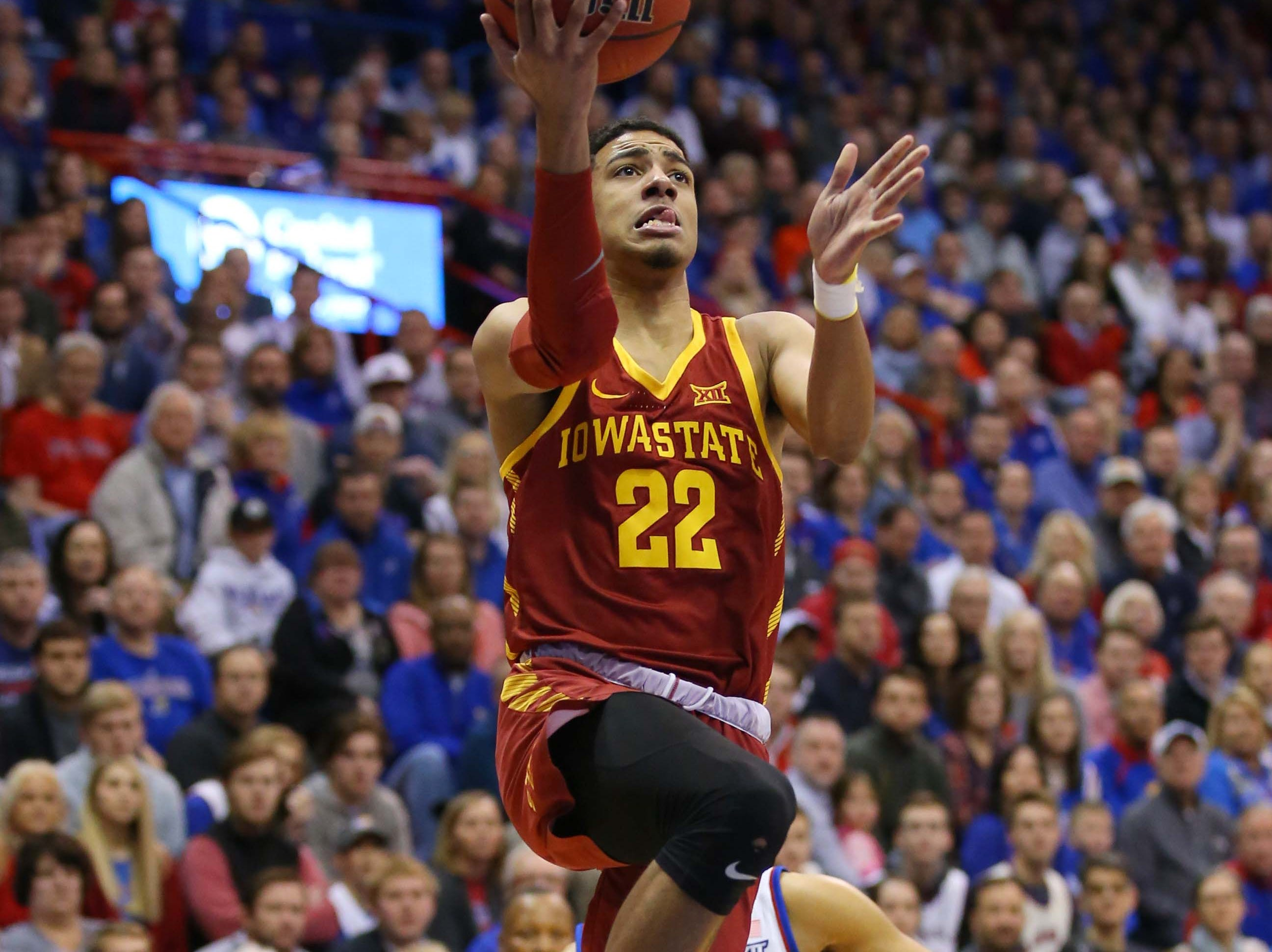 Iowa State Cyclones guard Tyrese Haliburton (22) goes up for a shot as Kansas Jayhawks guard Devon Dotson (11) defends in the first half at Allen Fieldhouse.