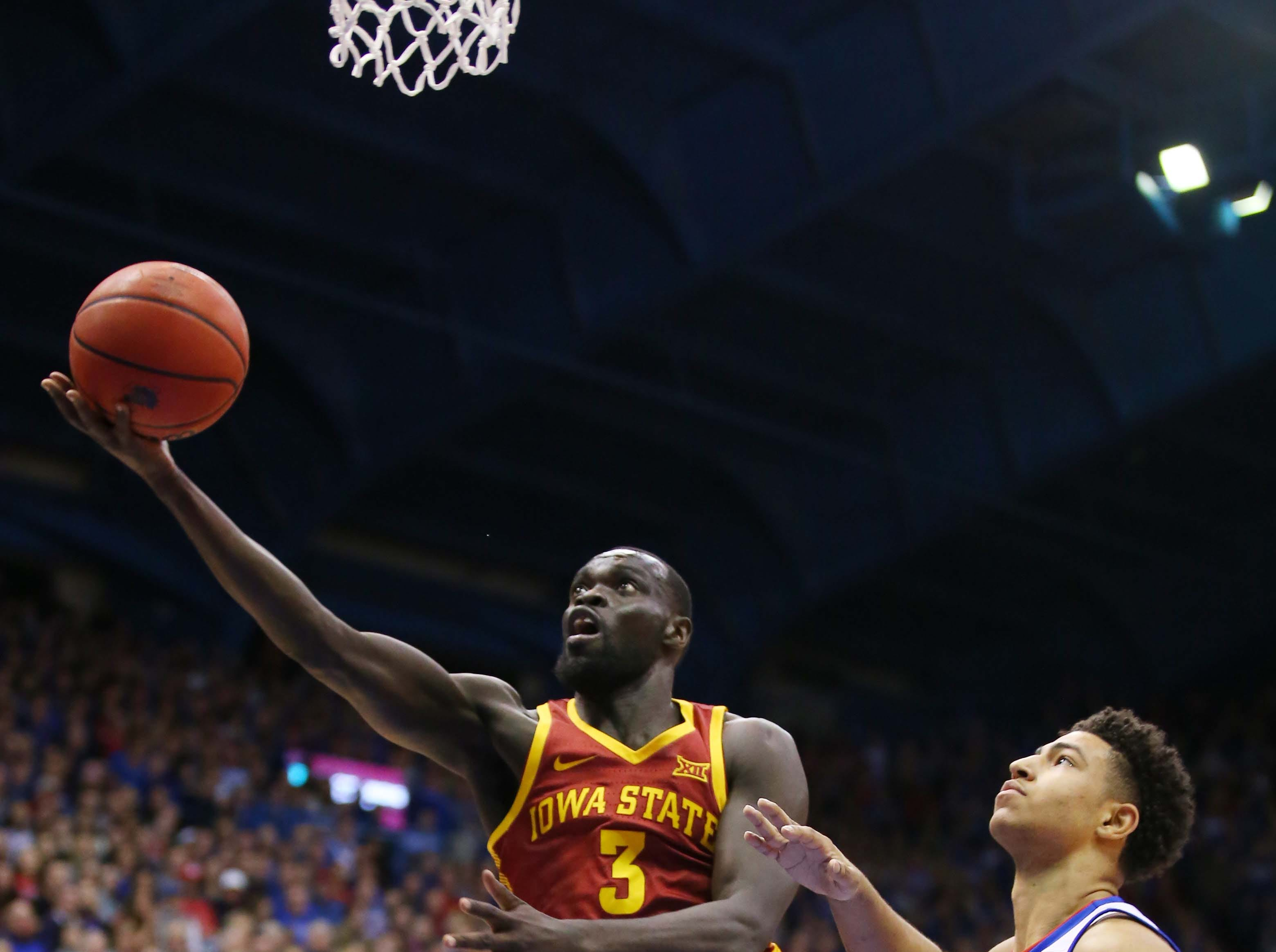 Iowa State Cyclones guard Marial Shayok (3) shoots a layup as Kansas Jayhawks guard Quentin Grimes (5) defends in the first half at Allen Fieldhouse.
