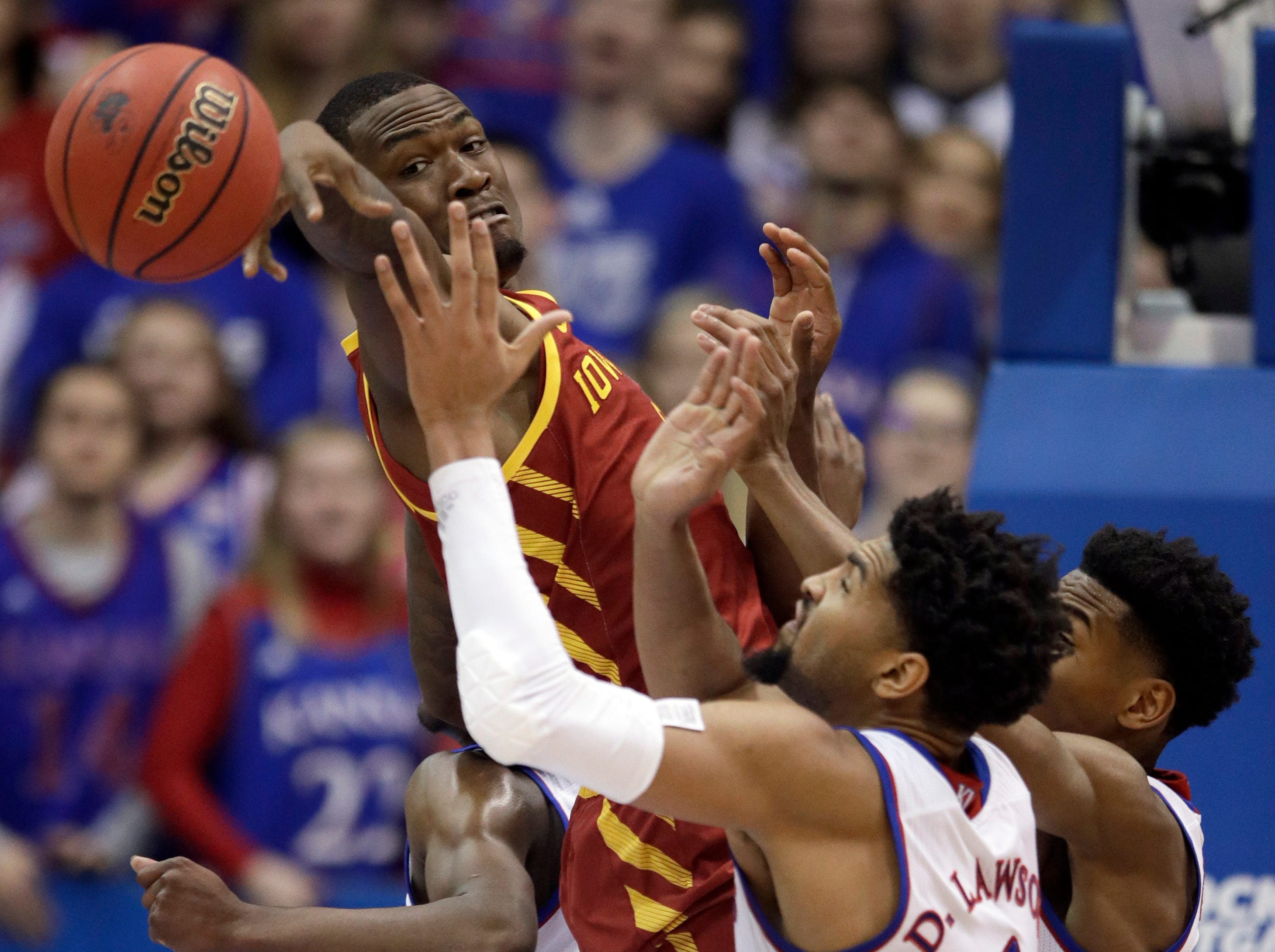 Iowa State forward Cameron Lard, left, tries to rebound over Kansas forward Dedric Lawson (1) and guard Ochai Agbaji, right, during the first half of an NCAA college basketball game in Lawrence, Kan., Monday, Jan. 21, 2019.