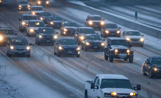 Traffic moves slowly eastward on Interstate 235 in Des Moines as another round of winter weather hits central Iowa on Tuesday, Jan. 22, 2019.
