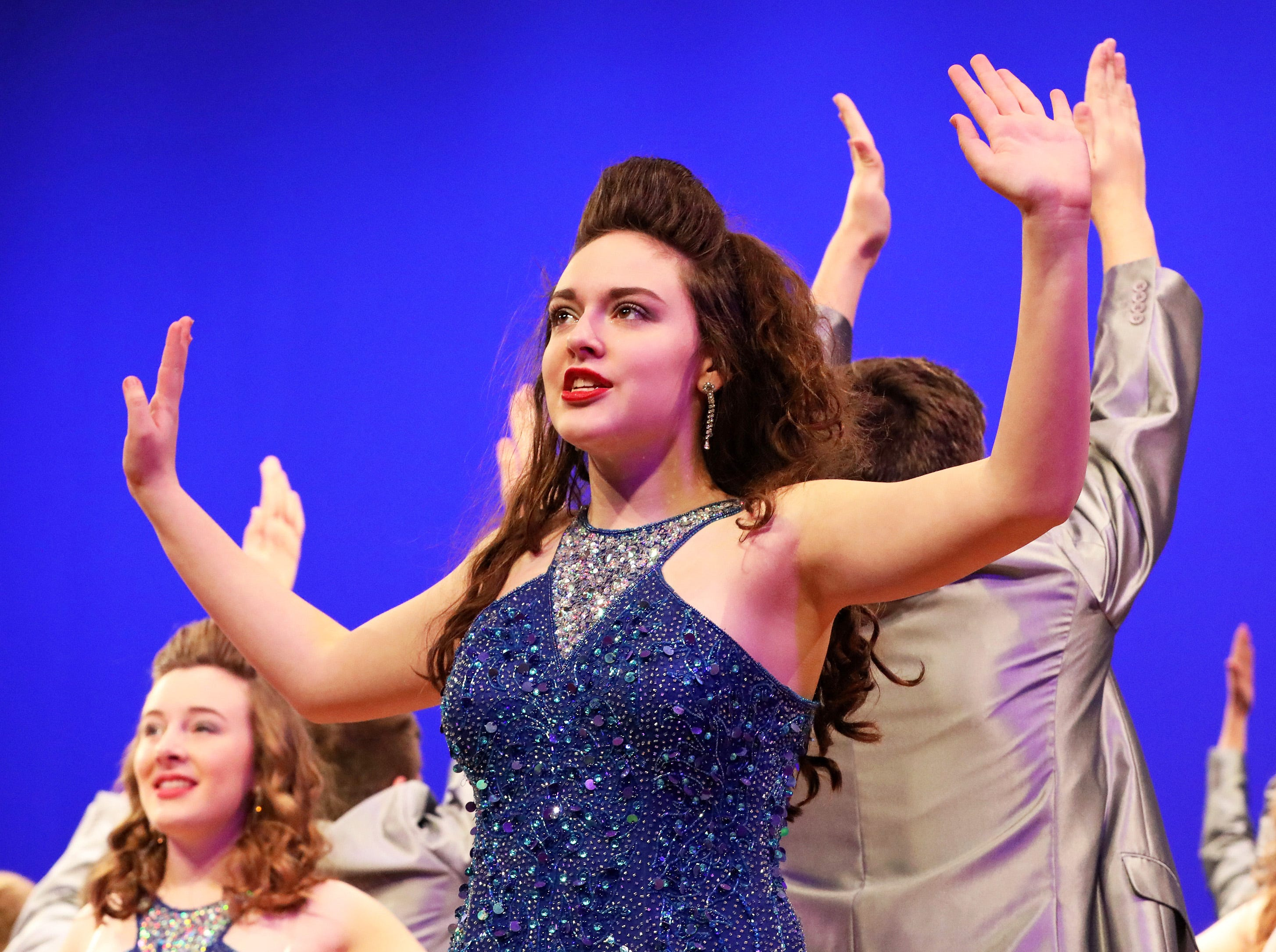 Show choir group Spirit from Waukee High is directed by Kathryn Mosiman. The group performed during the 23rd annual Showzam Show Choir Invitational featuring over 30 show choirs from central Iowa schools on Saturday, Jan. 19, 2019 in the auditorium of Johnston High School. Awards were presented for top choirs as well as for vocals, choreography, band, crew, female vocalist and male vocalist.