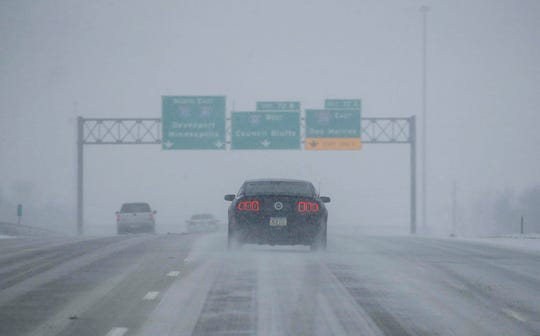 Traffic moves slowly along Interstate 35 south of West Des Moines as another round of winter weather hits central Iowa on Tuesday, Jan. 22, 2019, in Des Moines.
