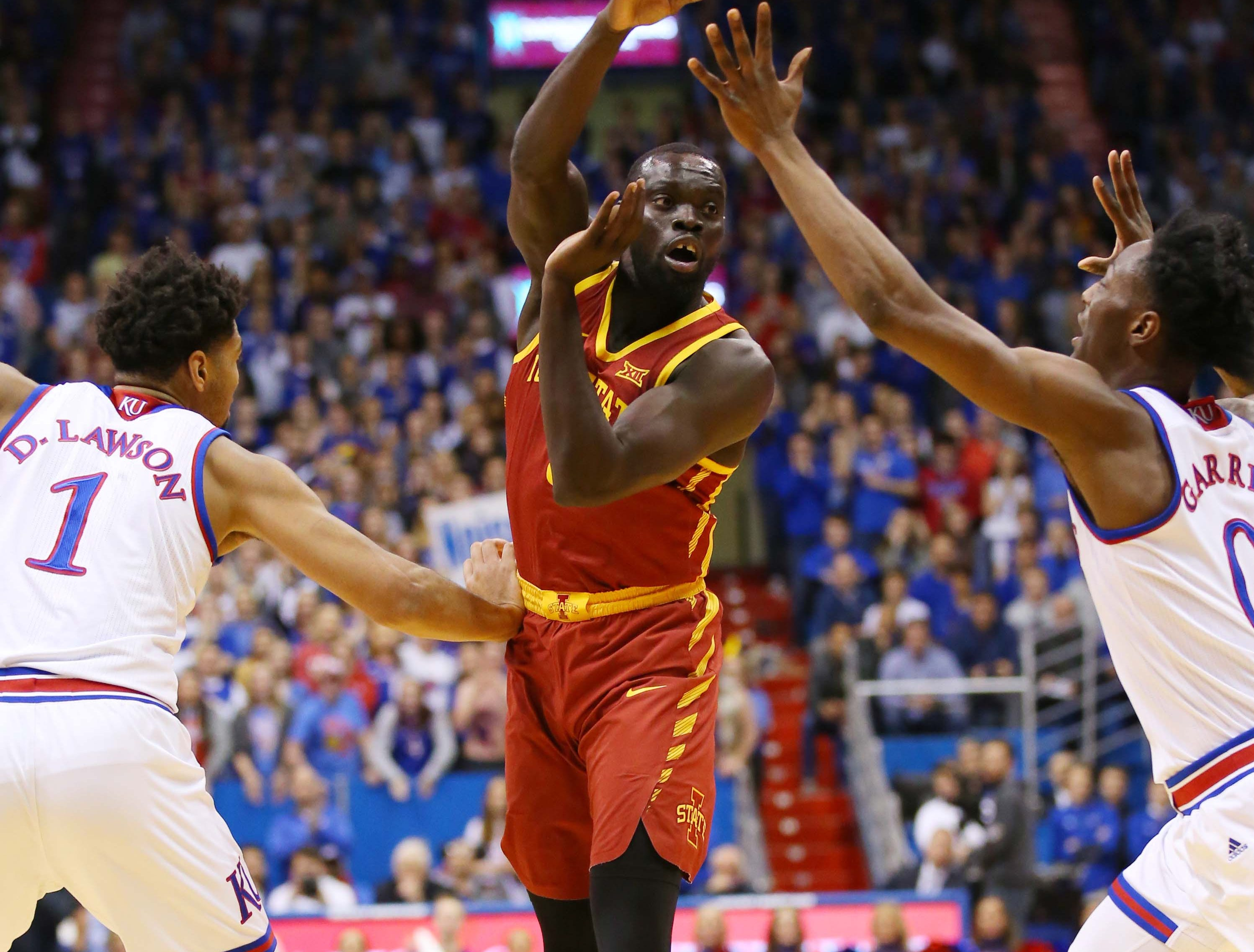 Iowa State Cyclones guard Marial Shayok (3) passes the ball as Kansas Jayhawks forward Dedric Lawson (1) and guard Marcus Garrett (0) defend in the first half at Allen Fieldhouse.