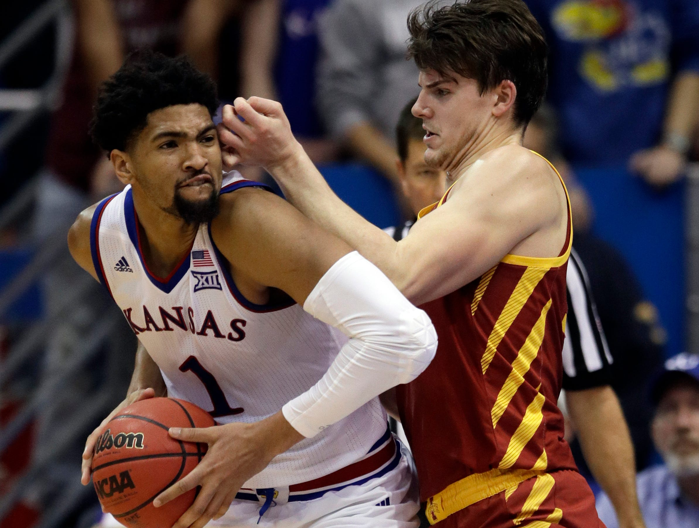 Kansas forward Dedric Lawson (1) drives on Iowa State forward Michael Jacobson (12) during the second half of an NCAA college basketball game in Lawrence, Kan., Monday, Jan. 21, 2019. Kansas defeated Iowa State 80-76.