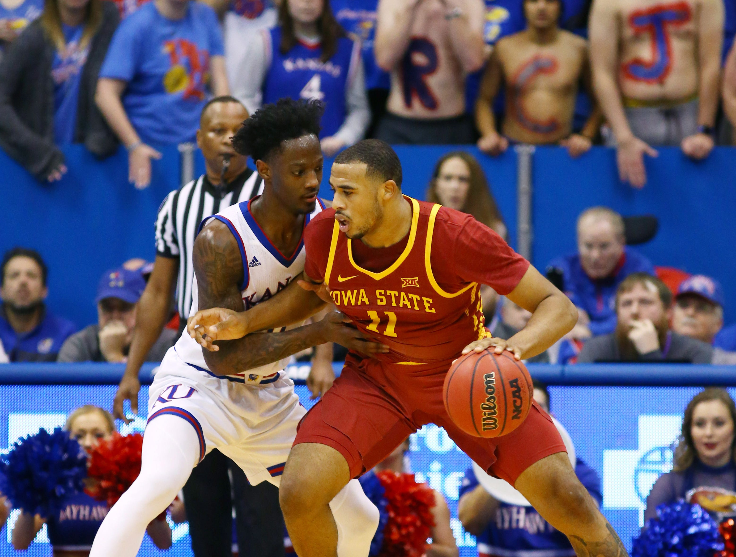 Iowa State Cyclones guard Talen Horton-Tucker (11) dribbles the ball against Kansas Jayhawks guard Marcus Garrett (0) in the second half at Allen Fieldhouse.