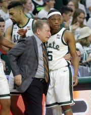 Michigan State head coach Tom Izzo and guard Cassius Winston embrace on the bench during second-half action against Maryland Monday, January 21, 2019 at the Breslin Center in East Lansing, Mich.