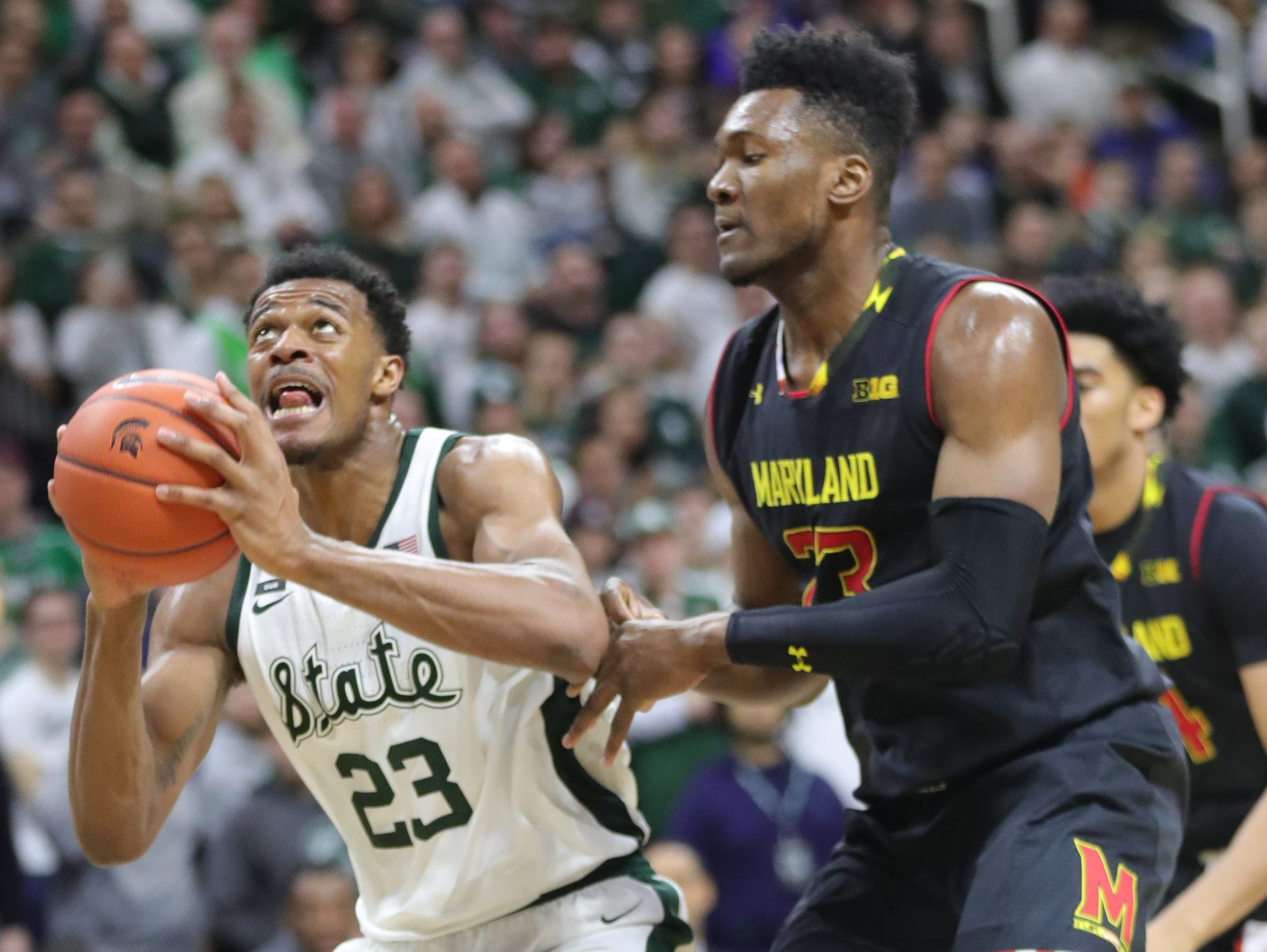 Michigan State forward Xavier Tillman drives against Maryland forward Bruno Fernando during second-half action Monday, January 21, 2019 at the Breslin Center in East Lansing, Mich.