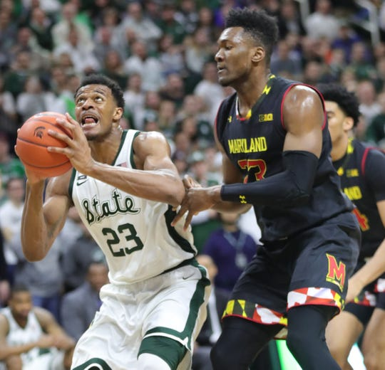 MSU's Xavier Tillmans drives against Maryland's Bruno Fernando during the second half on Monday night.