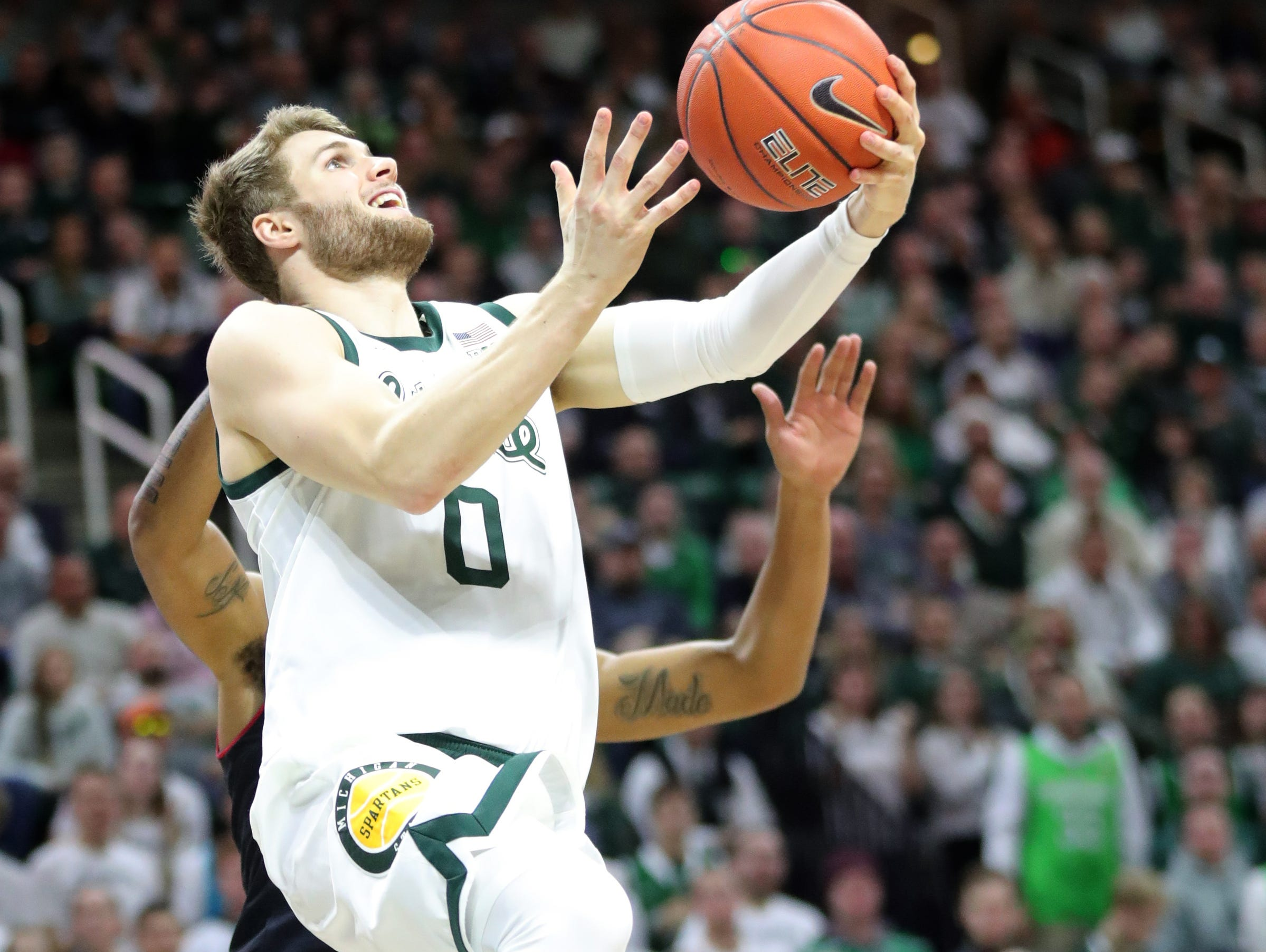 Michigan State guard Kyle Ahrens drives against Maryland guard Eric Ayala during second-half action Monday, January 21, 2019 at the Breslin Center in East Lansing, Mich.