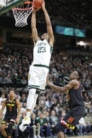 Michigan State forward Xavier Tillman scores against Maryland forward Jalen Smith during first-half action Monday, January 21, 2019 at the Breslin Center in East Lansing, Mich.