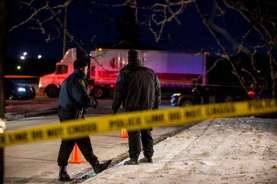 Police work the scene where an officer was shot and wounded during a traffic stop in Saginaw, Mich., Tuesday, Jan. 22, 2019.