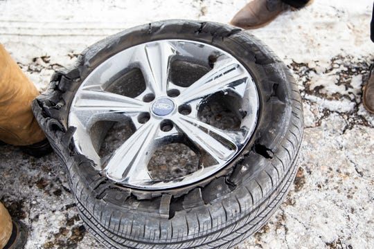Isabella Huetter's front tire was shredded as the 20-year-old was driving from her home in Fraser to Oakland University when she hit a pothole in the middle lane of I-75. Work crews close all but one lane on I-75 north of Big Beaver to patch pot holes that shredded tires Tuesday, Jan. 22, 2019.
