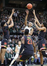 Michigan State guard Cassius Winston scores against Maryland during first half action Monday, January 21, 2019 at the Breslin Center in East Lansing, Mich.