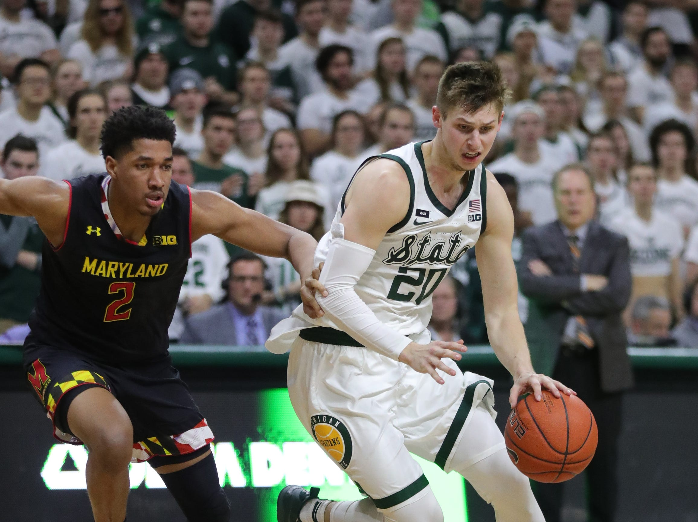 Michigan State guard Matt McQuaid drives against Maryland guard Aaron Wiggins during second-half action Monday, January 21, 2019 at the Breslin Center in East Lansing, Mich.