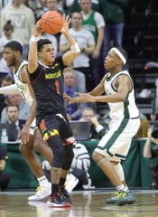 Michigan State guard Cassius Winston defends against Maryland guard Anthony Cowan Jr. during second-half action Monday, January 21, 2019 at the Breslin Center in East Lansing, Mich.