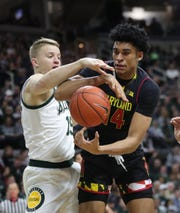 Michigan State forward Thomas Kithier rebounds against Maryland forward Ricky Lindo Jr. during first half action Monday, January 21, 2019 at the Breslin Center in East Lansing, Mich.