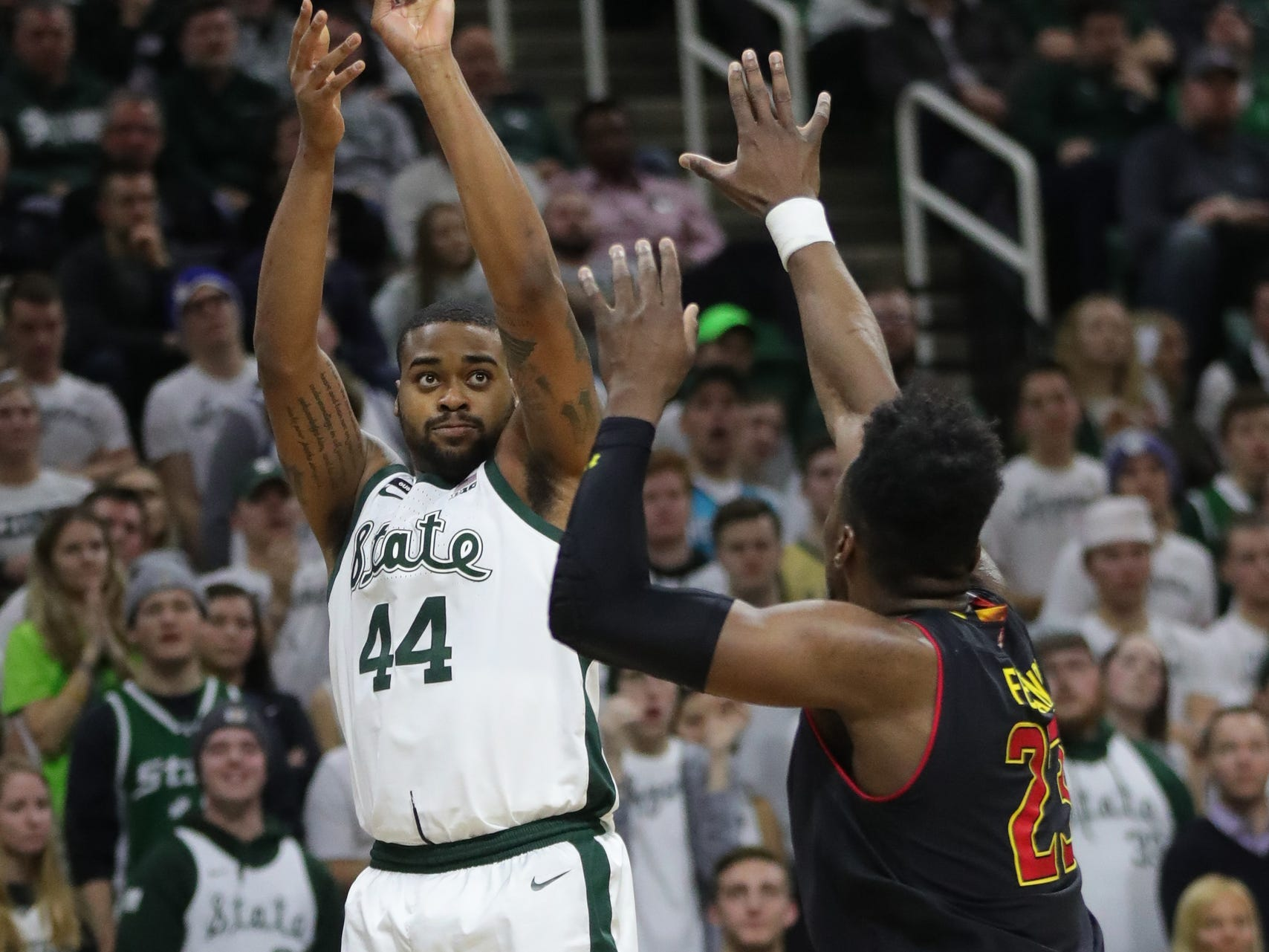 Michigan State forward Nick Ward shoots against Maryland forward Bruno Fernando during second-half action Monday, January 21, 2019 at the Breslin Center in East Lansing, Mich.
