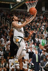 Back from a back injury, Kyle Ahrens puts in a reverse layup in the second half.