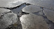 "Michigan State Police warned of potholes on I-75 in Oakland County and added: ""You can expect these potholes to pop up all the way until the road construction begins in March."""