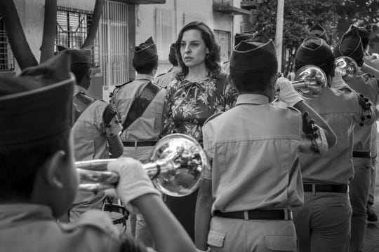 "This image released by Netflix shows Marina de Tavira, center, in a scene from the film ""Roma,"" by filmmaker Alfonso Cuaron."