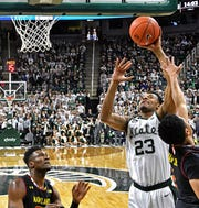 Michigan State's Xavier Tillman banks a shot off the glass for two of his 10 points in the Spartans' 69-55 victory over the Maryland Terrapins Monday at the Breslin Center.