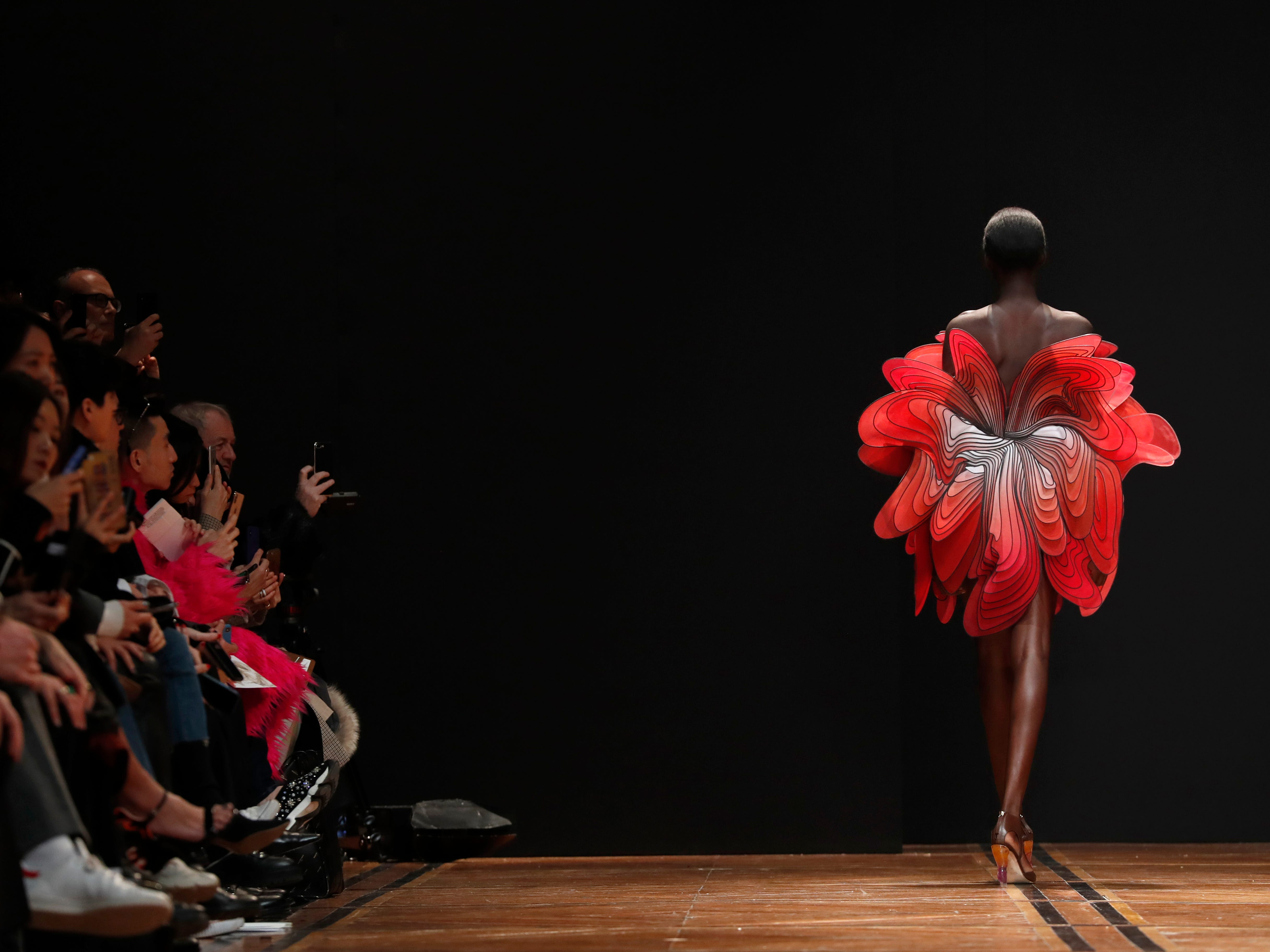 A model wears a creation for Iris van Herpen's Spring/Summer 2019 Haute Couture fashion collection presented in Paris, Monday, Jan. 21, 2019.