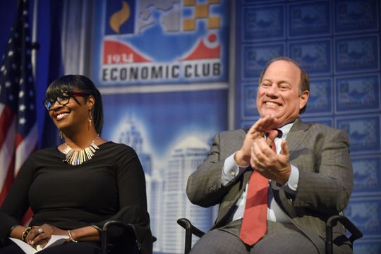 Motor City Java House owner, Alicia George, and Mayor Mike Duggan, right, told the Detroit Economic Club that revitalization is reaching the city's neighborhoods, even as property values rise.