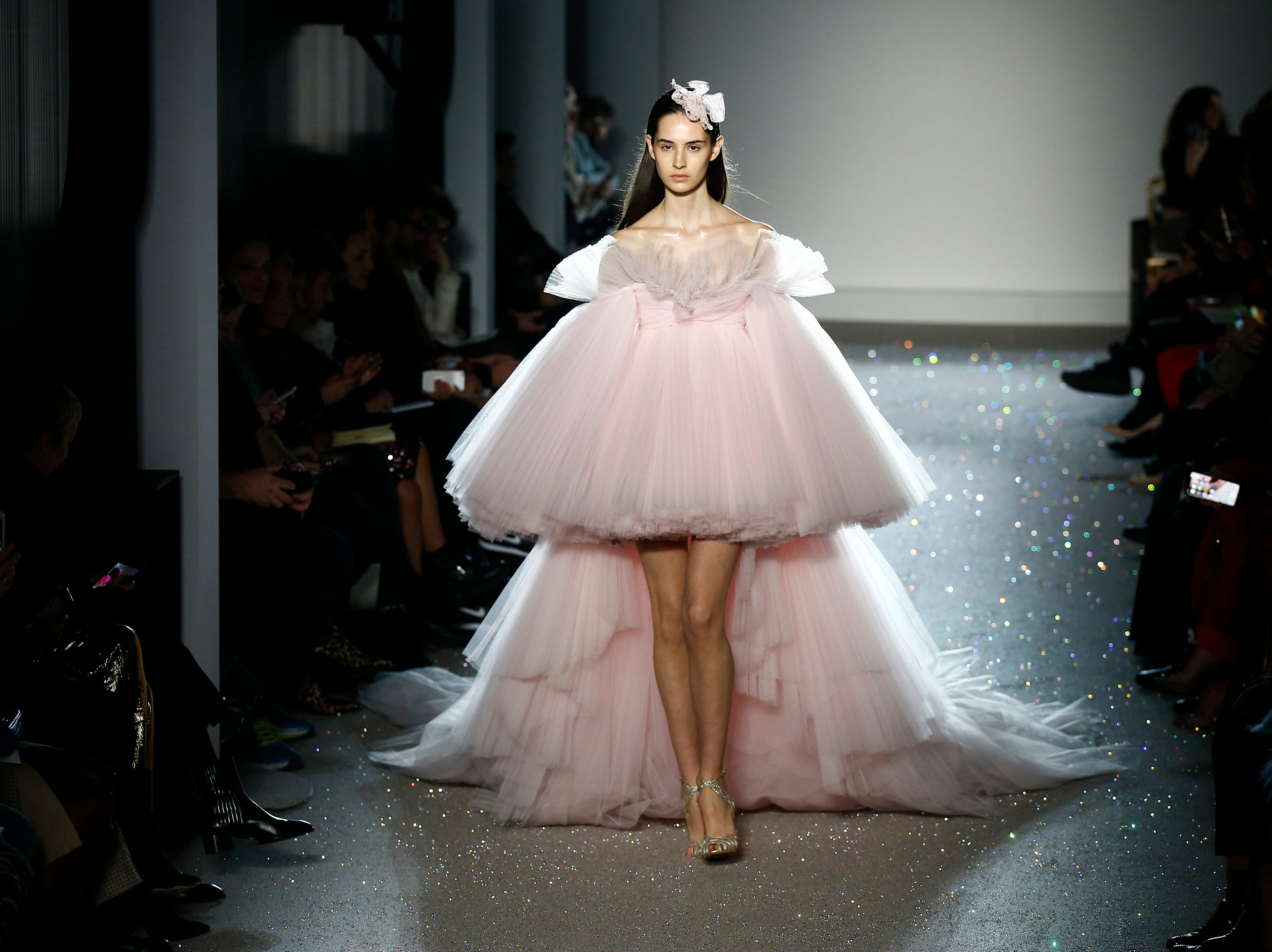 A model wears a creation for the Giambattista Valli Spring/Summer 2019 Haute Couture fashion collection presented in Paris, Monday, Jan. 21, 2019.