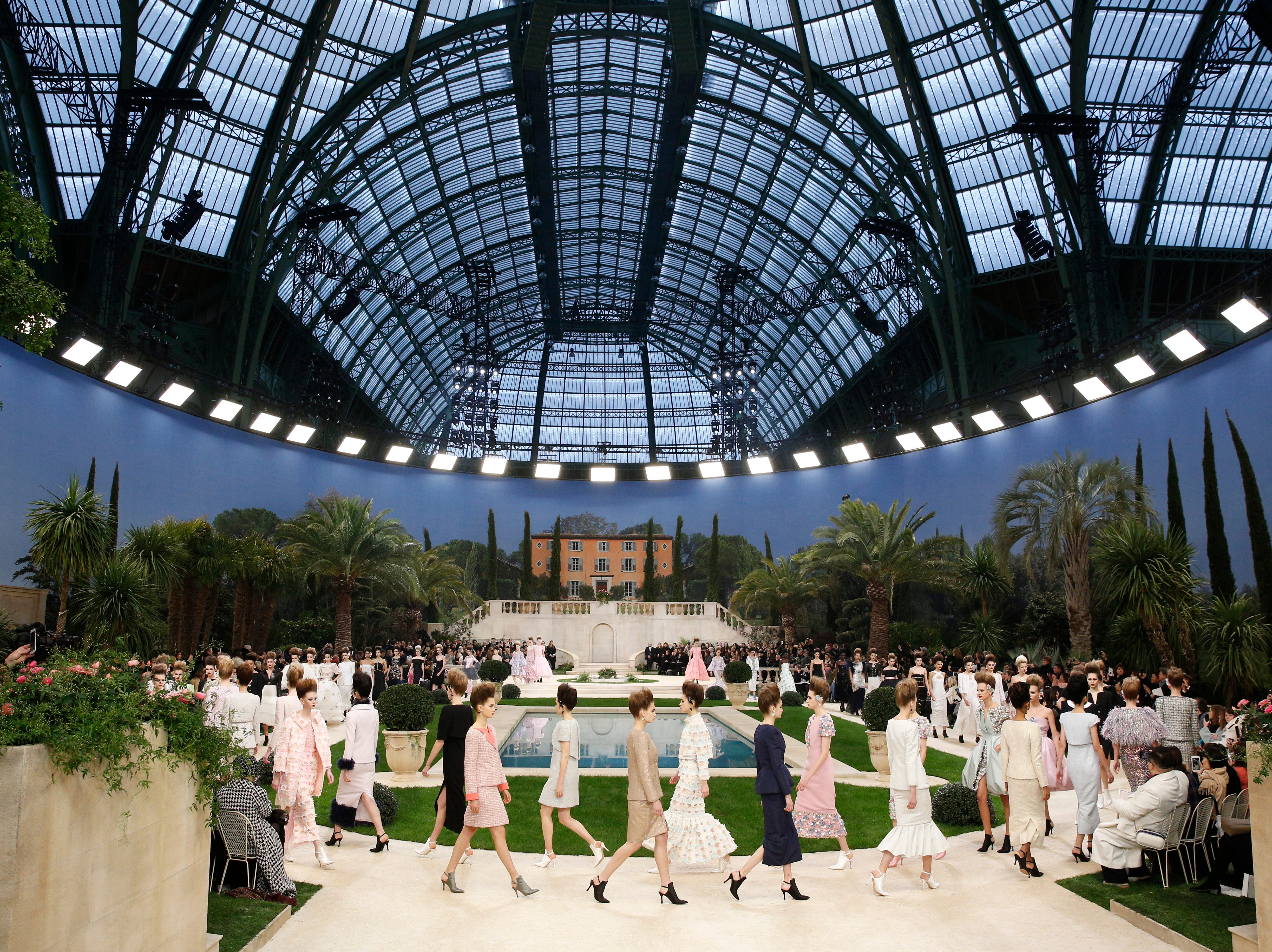 Models wear creations for the Chanel Spring/Summer 2019 Haute Couture fashion collection presented in Paris, Tuesday, Jan. 22, 2019.