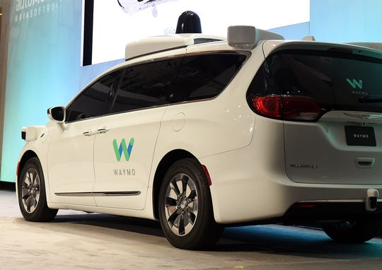 The original self-driving Chrysler Pacifica vehicles deployed by Waymo LLC featured the tech company's logo on the side.