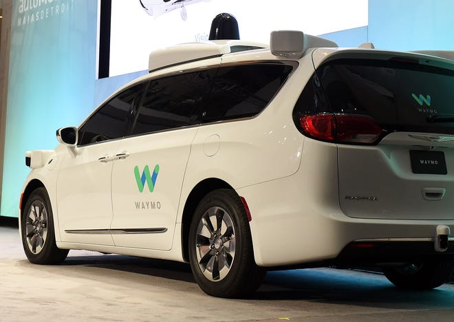 A Chrysler Pacifica is outfitted with Waymo LLC's self-driving system. The Google spinoff says it will invest up to $13.6 million in a facility in Detroit to integrate its technology into automaker partners' vehicles.