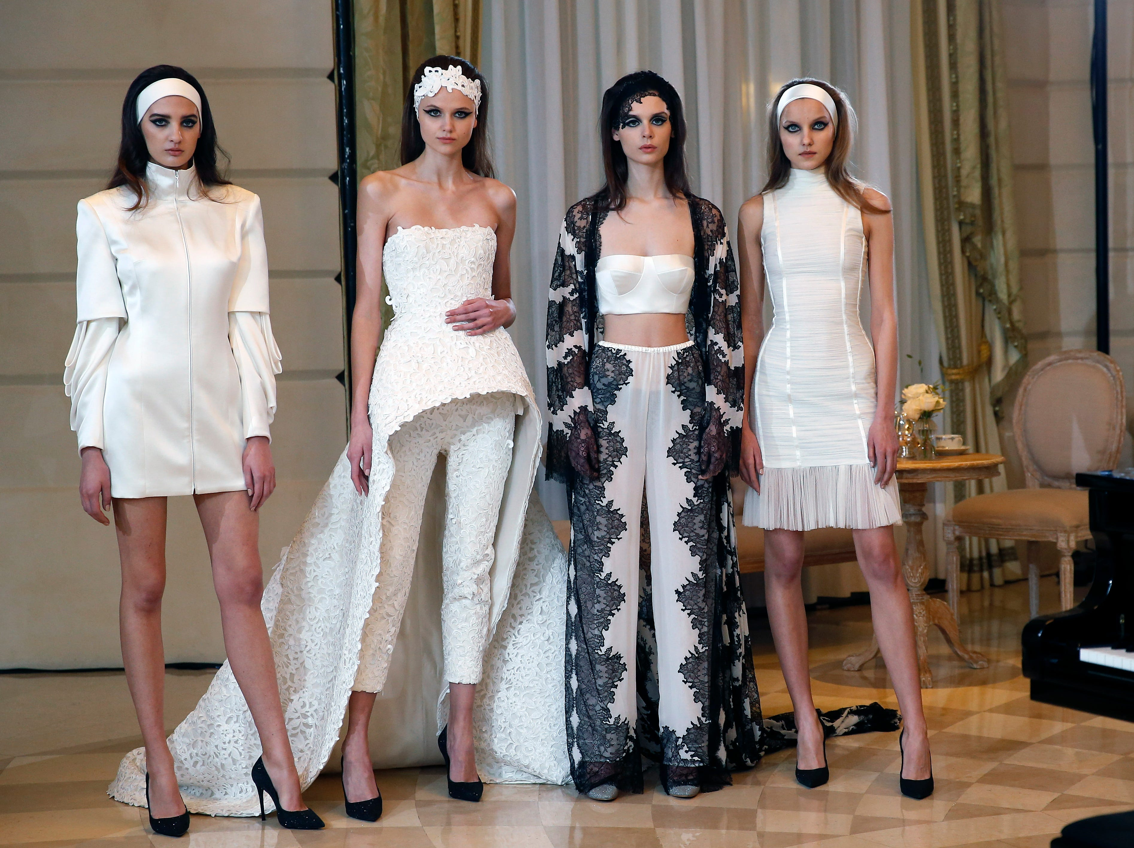 Models showcase designs by Atelier August Getty during their Spring Summer 2019 Presentation as part of Paris Fashion Week on Tuesday, Jan. 22, 2019 in Paris.