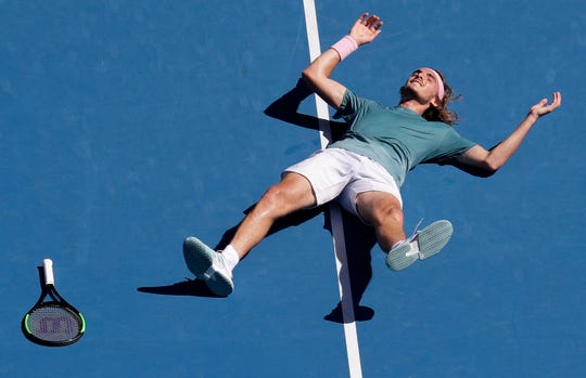 Greece's Stefanos Tsitsipas celebrates after defeating Spain's Roberto Bautista Agut in their quarterfinal match at the Australian Open tennis championships  Tuesday in Melbourne, Australia.