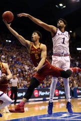 Lindell Wigginton of the Iowa State Cyclones drives to the basket as Dedric Lawson of the Kansas Jayhawks defends Monday. Kansas won, 80-76.