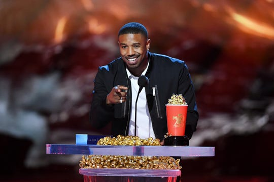 Actor Michael B. Jordan accepts the Best Villain award for 'Black Panther' onstage during the 2018 MTV Movie And TV Awards at Barker Hangar on June 16, 2018 in Santa Monica, California.