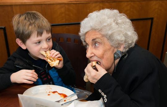 Olga Loizon dines with a young customer.