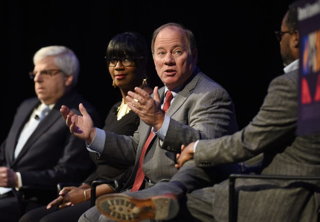 Detroit Mayor Mike Duggan, center, speaks about the city neighborhoods in during the 2019 Detroit Economic Club luncheon along with Gary Torogow, from left, chairman of Chemical Financial Corp., Alicia George, founder of Java House & Artist Village Detroit, and moderator Stephen Henderson at Cobo Center on Tuesday.