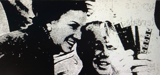 "Budd Boetticher (right) examines the negatives of his long-delayed documentary ""Arruza"" alongside Maria Arruza."
