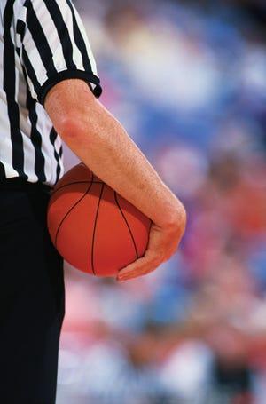 Referee holding a basketball