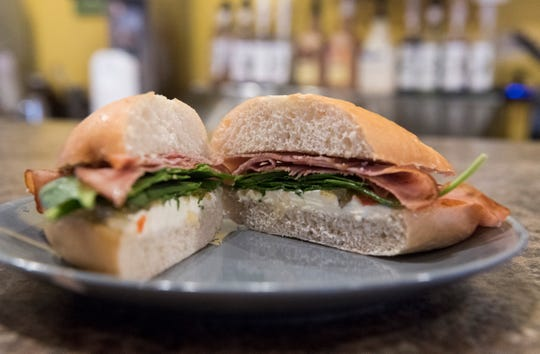 The Penny Lane Coffeehouse Almost Famous sandwhich made with a bolilo roll, smoked ham, cream cheese, spinach and pineapple habanero spread.