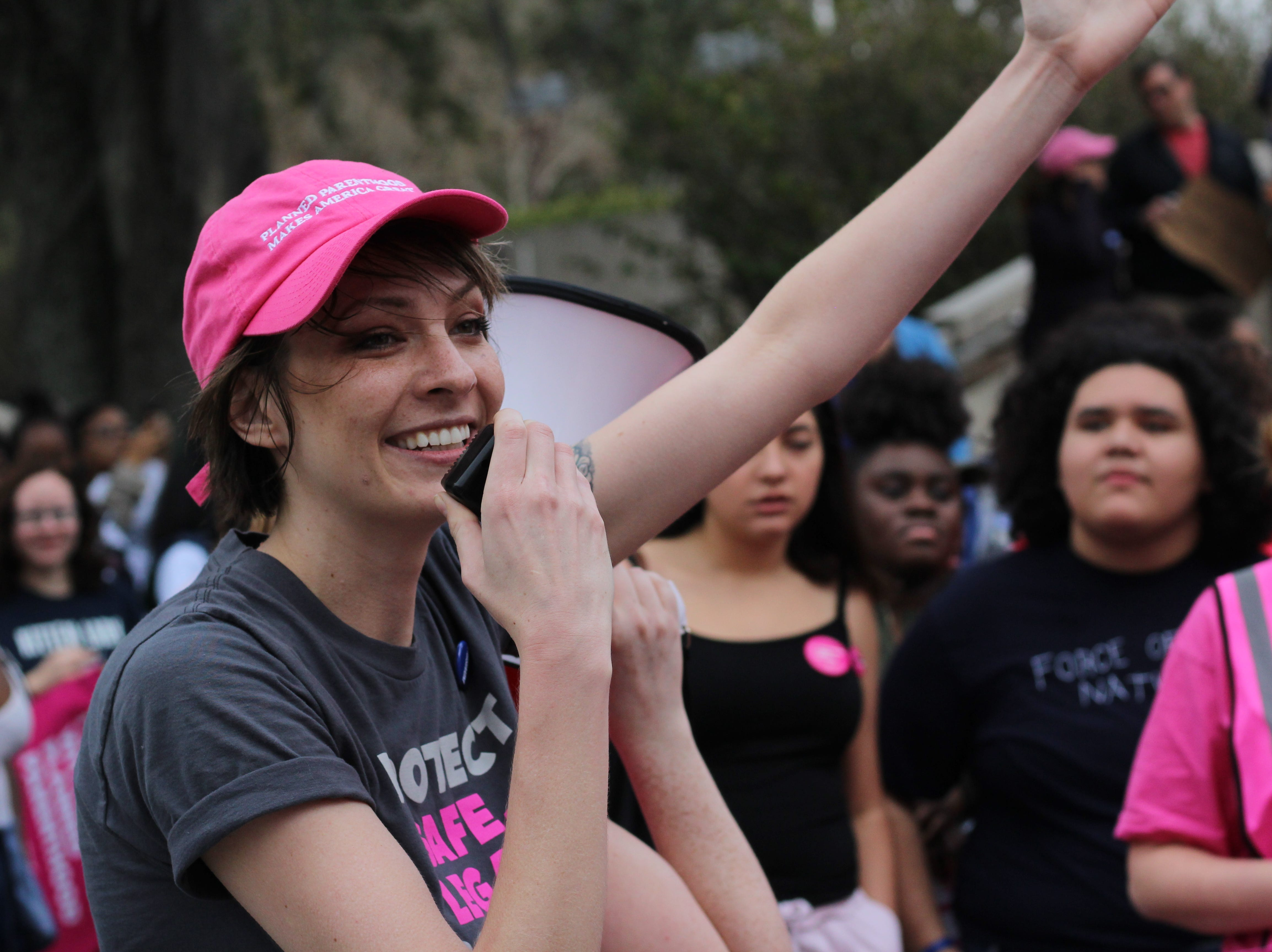 Community members gather for Tallahassee's Women's March to advocate for women's rights.