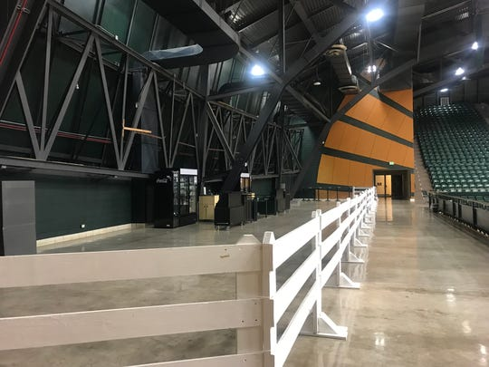 A fence separates the Moby Loft, where fans will be able to purchase and drink beer and wine during basketball and volleyball games, from the general seating areas at Colorado State University's Moby Arena. The loft opened for the first time Saturday for a women's basketball game against Utah State.